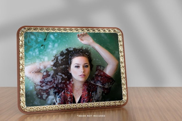 Realistic gold photo frame mockup