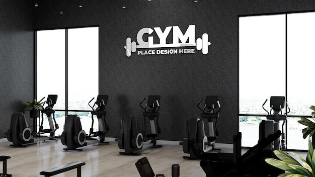 Реалистичный макет логотипа спортзала в фитнес-зале для упражнений спортсмена