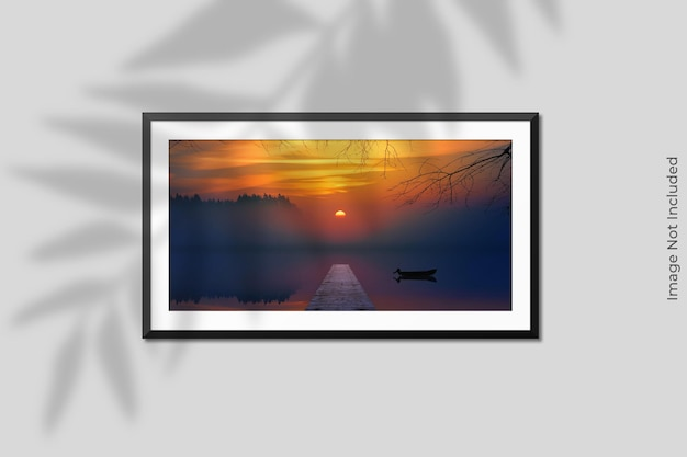 Realistic horizontal frame mockup hanging on wall with shadow overlay