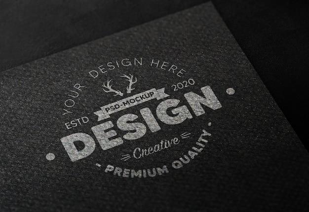 Realistic logo mockup in black paper