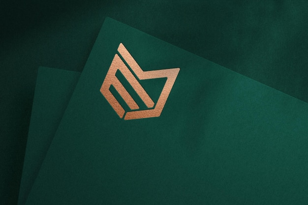 Realistic logo mockup on green paper with debossed effect