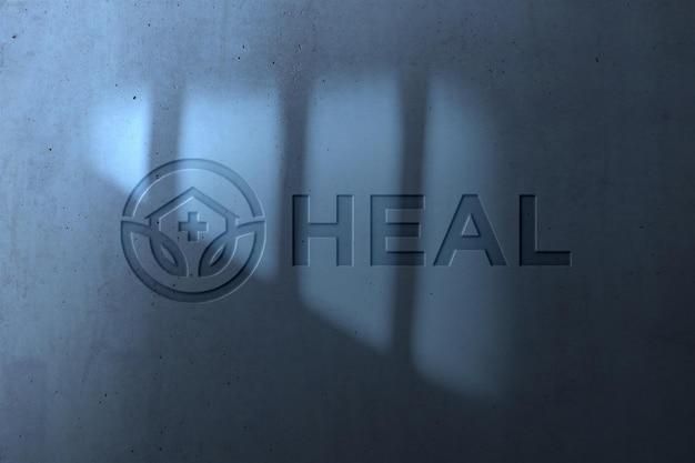 Realistic logo mockup on wall