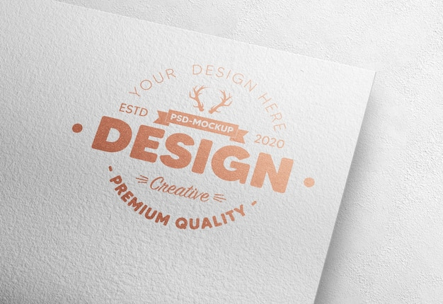 Realistic logo mockup in white paper with bronze foil