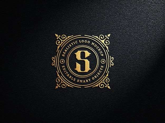 Realistic luxury embossed gold logo mockup on dark wall