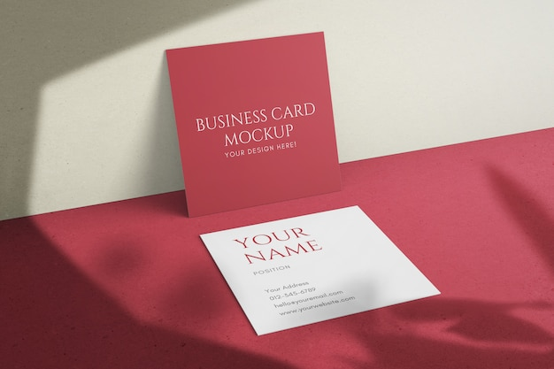 Realistic minimalist square corporate business card with shadows overlay mockup