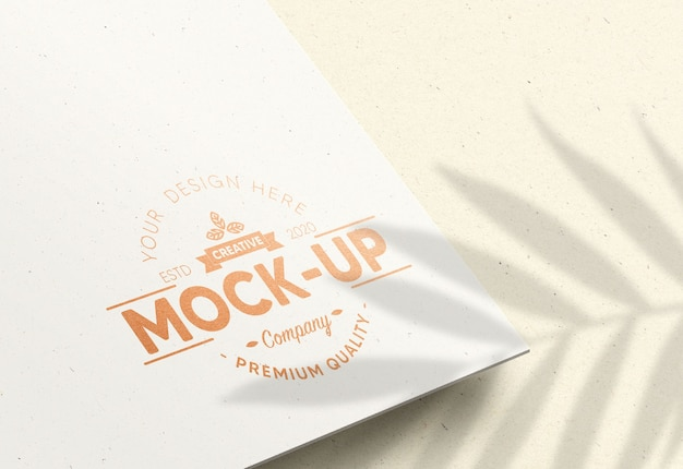 Realistic mockup logo in white paper with bronze foil effect Premium Psd
