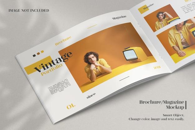 Realistic opened brochure or magazine mockup