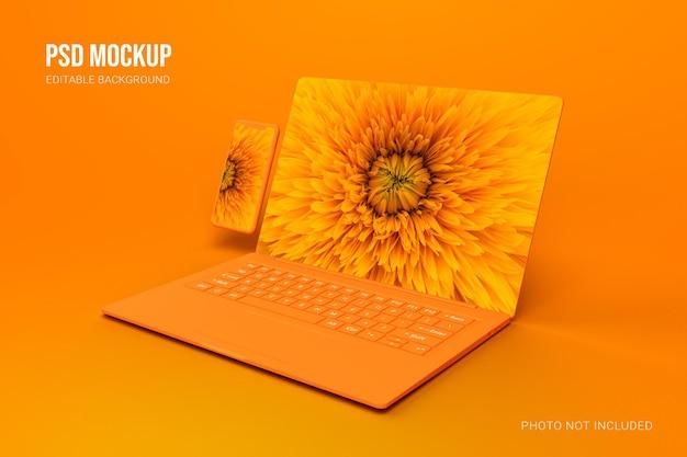 현실적인 오렌지 클레이 노트북 및 스마트 폰 모형 장면 제작자