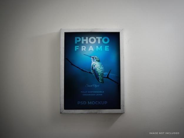 Realistic photo frame mockup on white wall