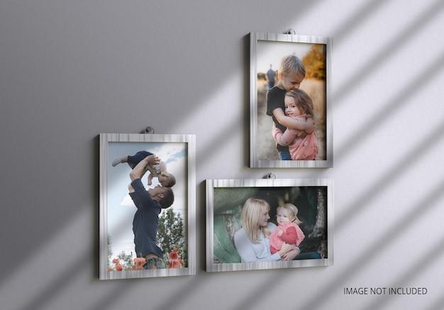 Realistic shadow family photo frame mockup on wall