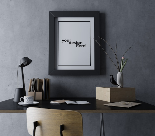 Realistic single poster frame mockup design template hanging portrait on concrete wall in modern black workspace