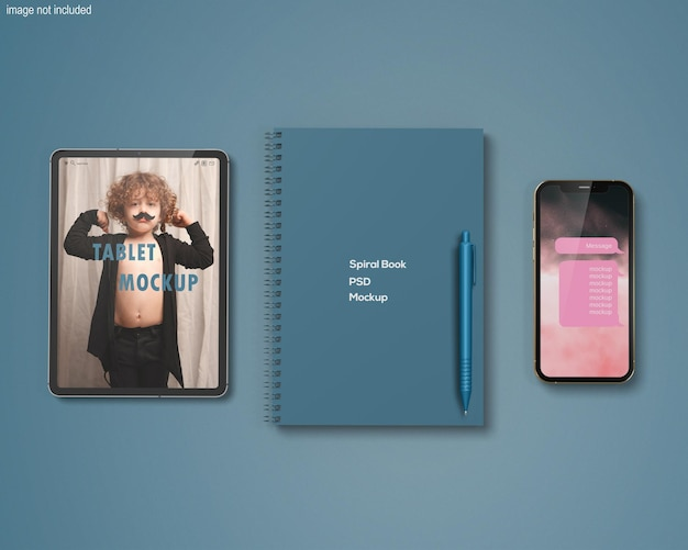 Realistic spiral notebook or tablet and phone mockup