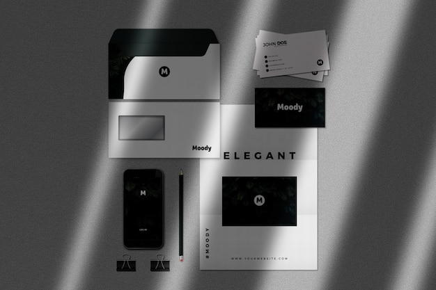 Realistic stationery mockup with phone and business cards