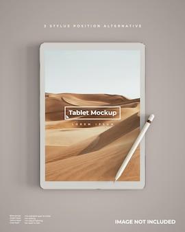 Реалистичный макет планшета со стилусом в вертикальном положении, вид сверху