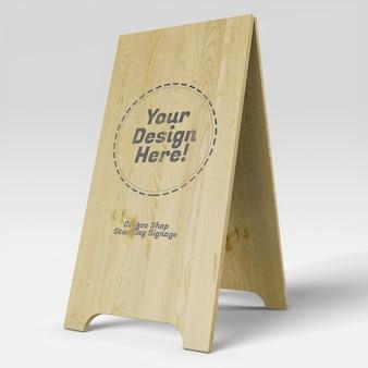 木製の看板モックアップに立っている現実的な背の高いコーヒーショップ