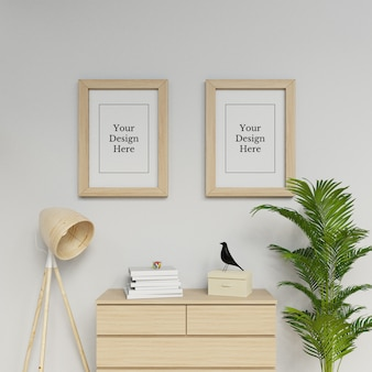Realistic two a2 poster frame mock up design template hanging portrait in modern space