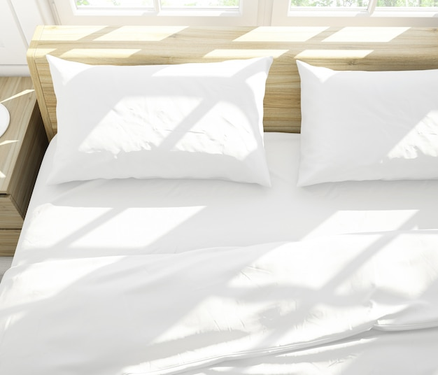 Realistic white pillows on a double bed