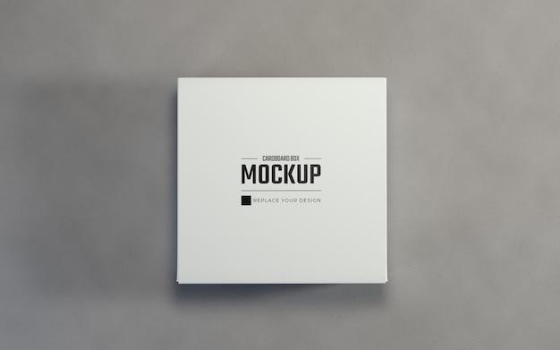 リアルな白い正方形の段ボール箱のパッケージのモックアップ