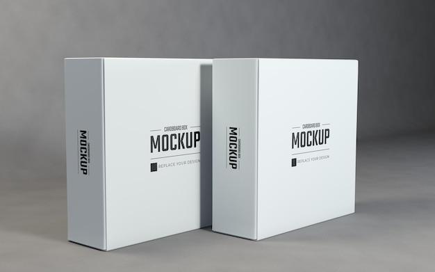 灰色の背景を持つ現実的な白い正方形の段ボール箱のモックアップデザイン