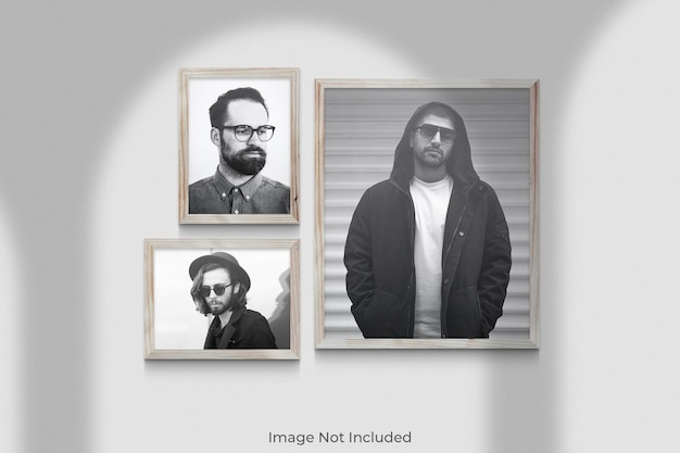Realistic wooden frames mockup hanging on wall with shadow overlay