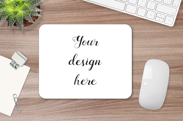 Rectangle mouse pad on a table, mockup.