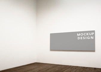 Rectangular frame mockup design on a white wall