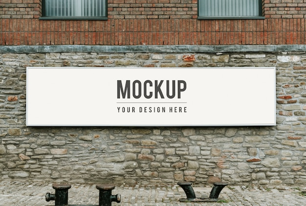 Rectangular public signage mockup on a brick wall