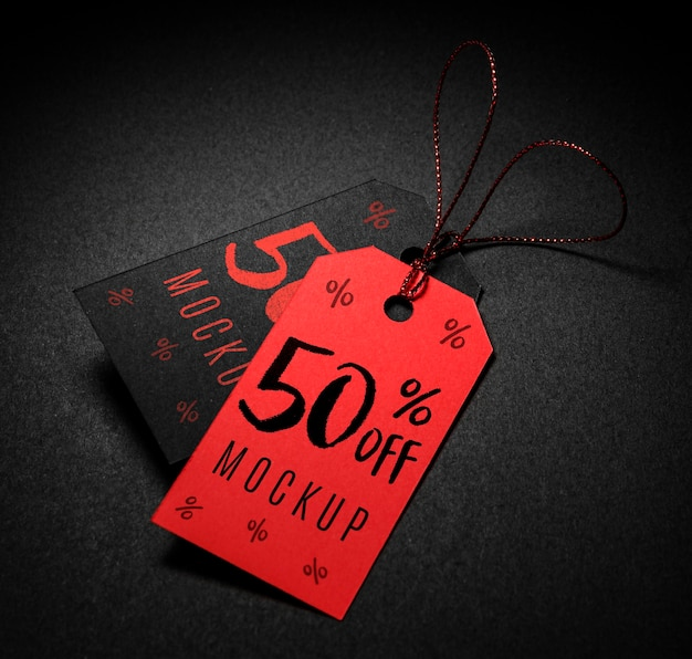 Red and black price tags with thread black friday sales mock-up