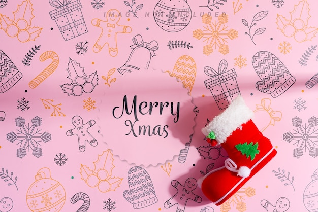 Red christmas socking with festive decoration, merry xmas message