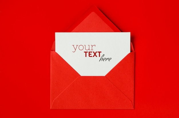 Red envelope with blank white paper. valentine's day background. mock up of love letter.