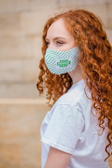 Red hair woman with medical protective face mask