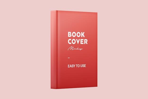 赤い立っている光沢のある本の表紙のモックアップ