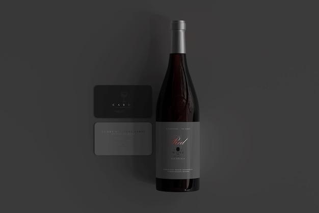 명함 모형과 레드 와인 병