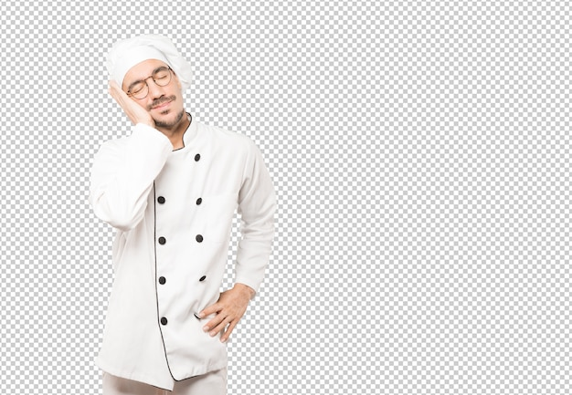 Расслабленный молодой шеф-повар делает жест сна
