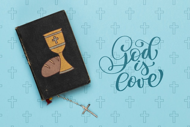 Religious concept with bible and cross necklace