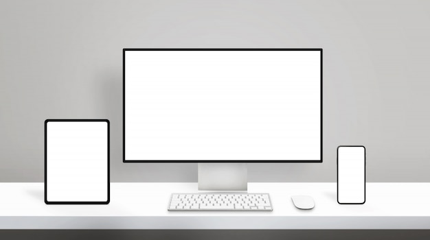 Responsive design on modern different display devices mockup. computer display, tablet and smart phone on clean office desk