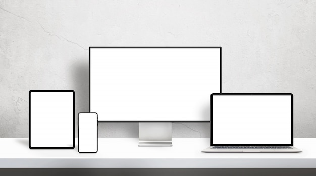 Responsive devices on desk with isolated screen for mockup on office desk
