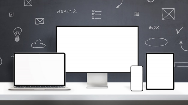 Responsive display devices on web designer desk mockup. office desk concept with isolated screens on computer display, laptop, phone and tablet. web design elements drawings in background