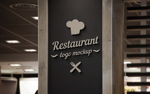 Restaurant 3d logo mockup on black wall.