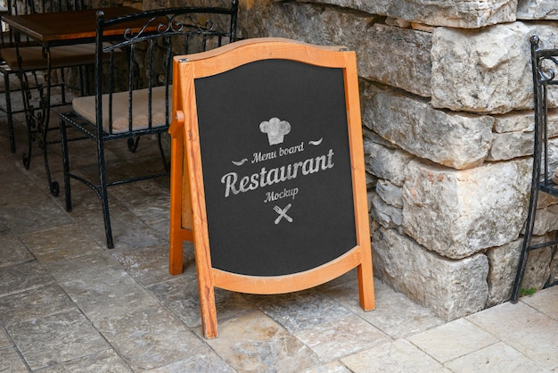 Restaurant blank menu board mockup for logo or offer promotion. old city street with stone walls and floor