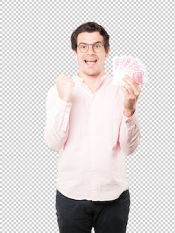 Rich young man holding money with his hands