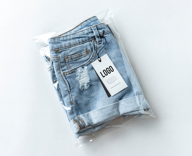 Ripped jean shorts with a tag mockup