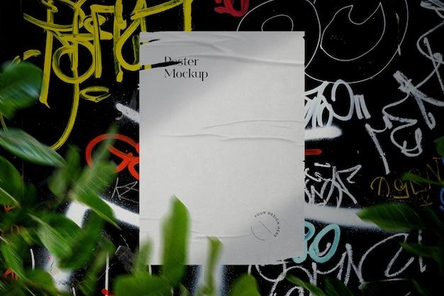 Ripped poster mockup on graffiti wall