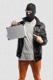 ブリーフケースを持つ強盗