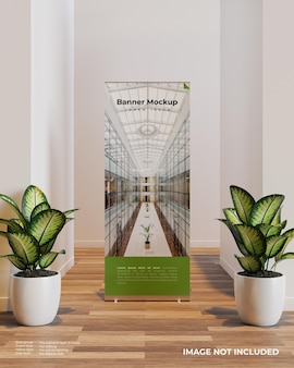 Roll up banner mockup in interior scene between two plants