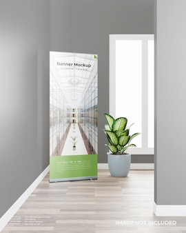 Roll up banner mockup with a plant in the room