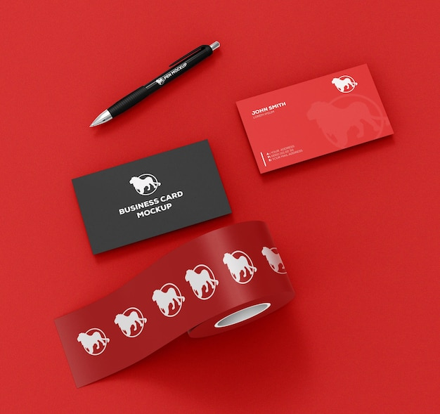 Roll with stickers and business card with pen mockup