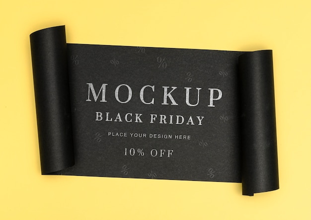 Rolled banner of yellow background black friday sales mock-up