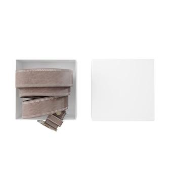 Rolled belt inside a white box
