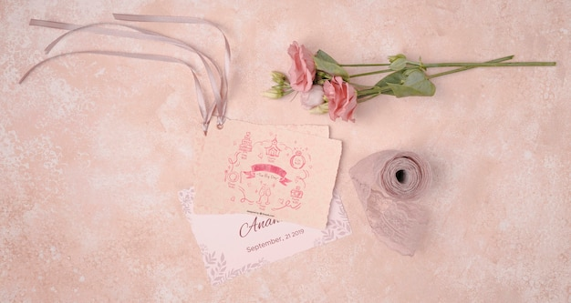 Romantic flowers with wedding invitation
